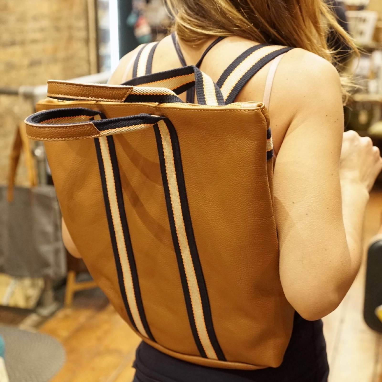 Leather Backpack With Canvas Straps And Handle In Dark Tan