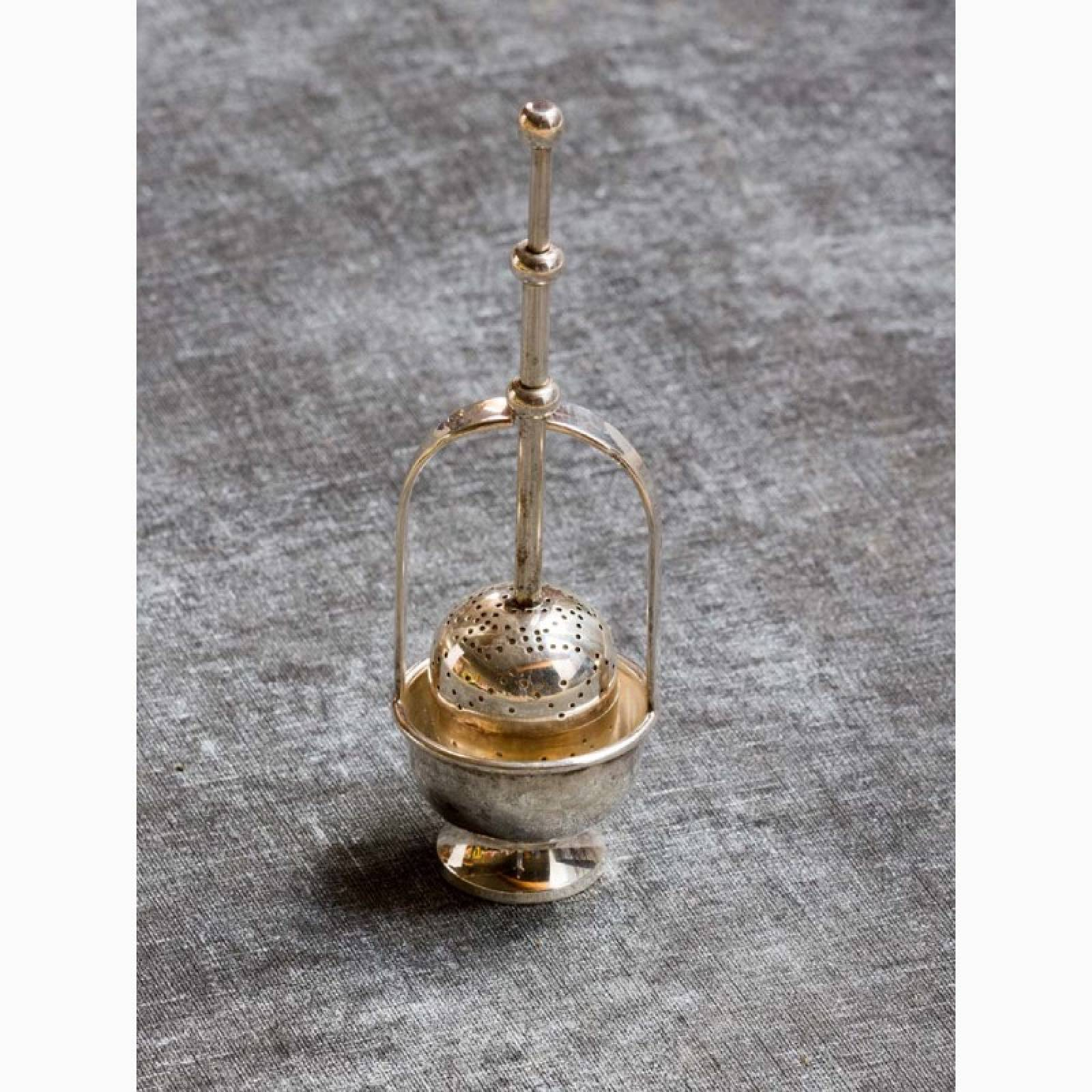 Push Down Tea Strainer On Stand In Antiqued Silver Finish thumbnails